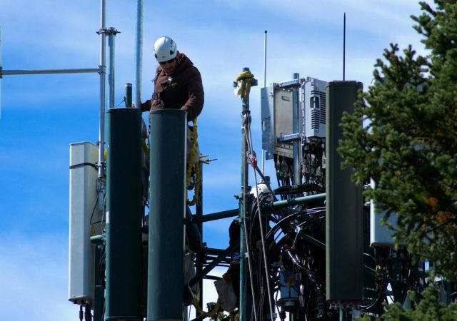 Technician Working On Cell Tower