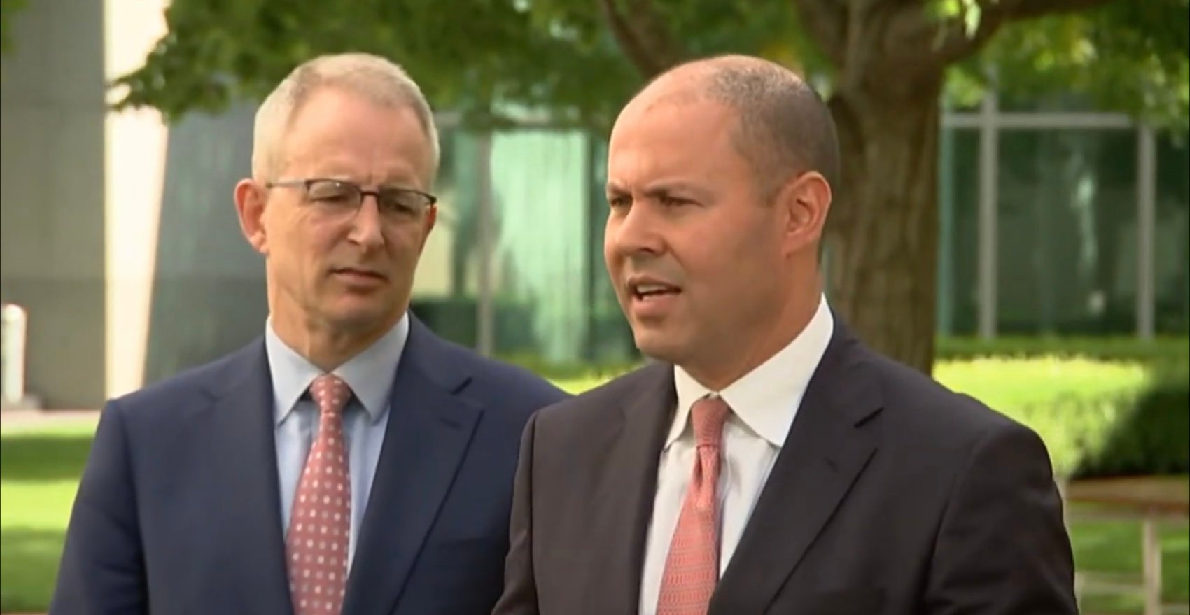 Australian Treasurer Josh Frydenberg (right) and Minister for Communications Paul Fletcher (left)