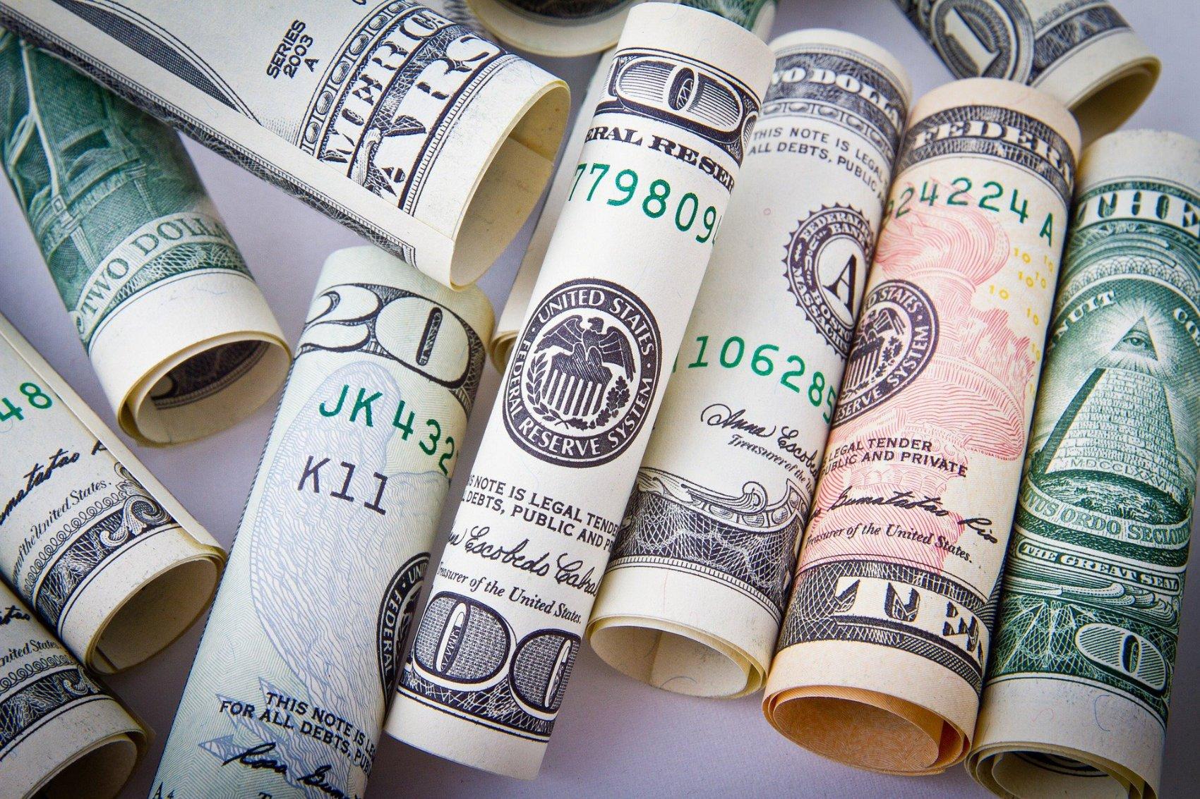 US Money - Image by Nikolay Frolochkin