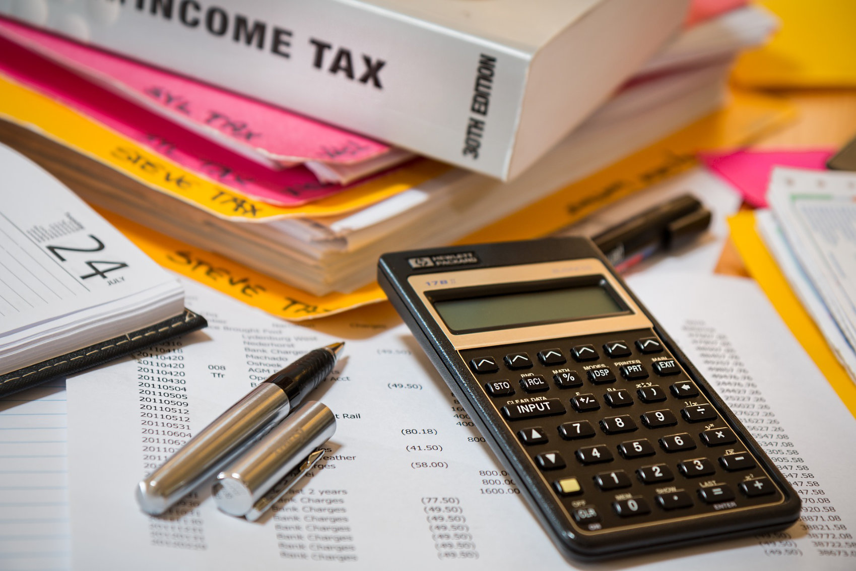 Income Tax Calculator - Image by Steve Buissinne