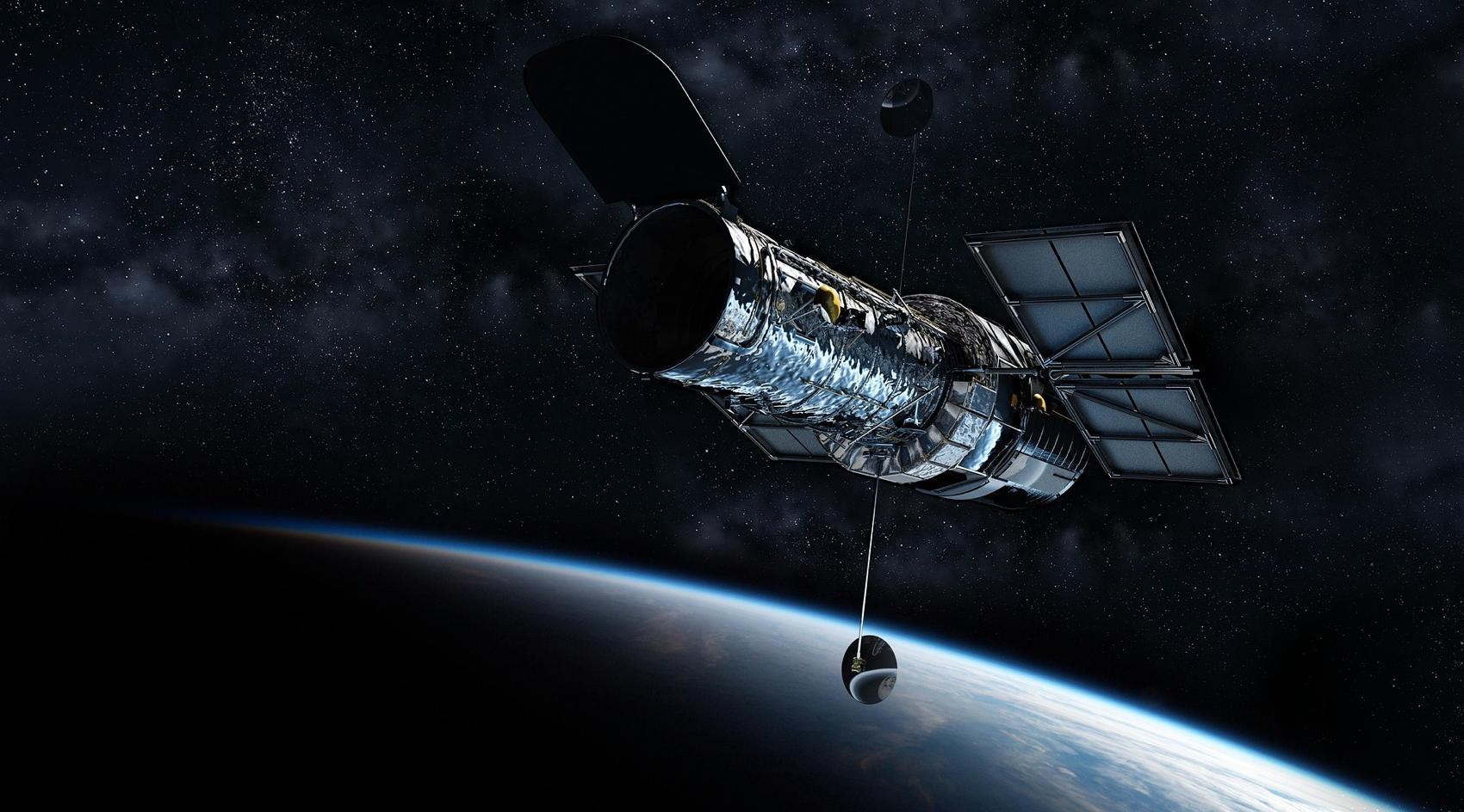 Hubble Telescope Against the Cosmos - Image by Ondřej Šponiar