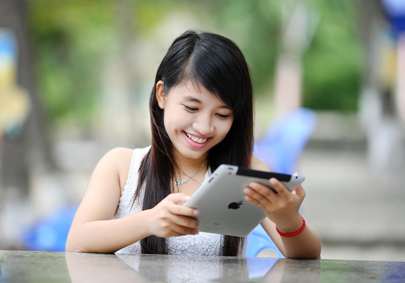 Girl Using iPad - Image by Jess Foami