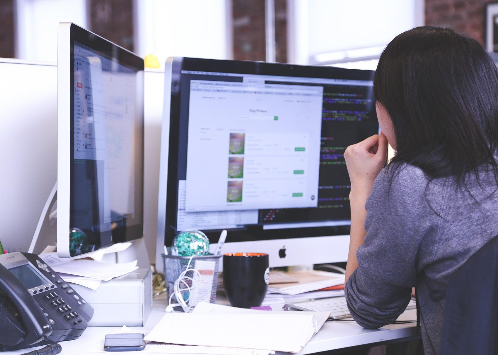 Woman at Workstatino - Image by StartupStockPhotos